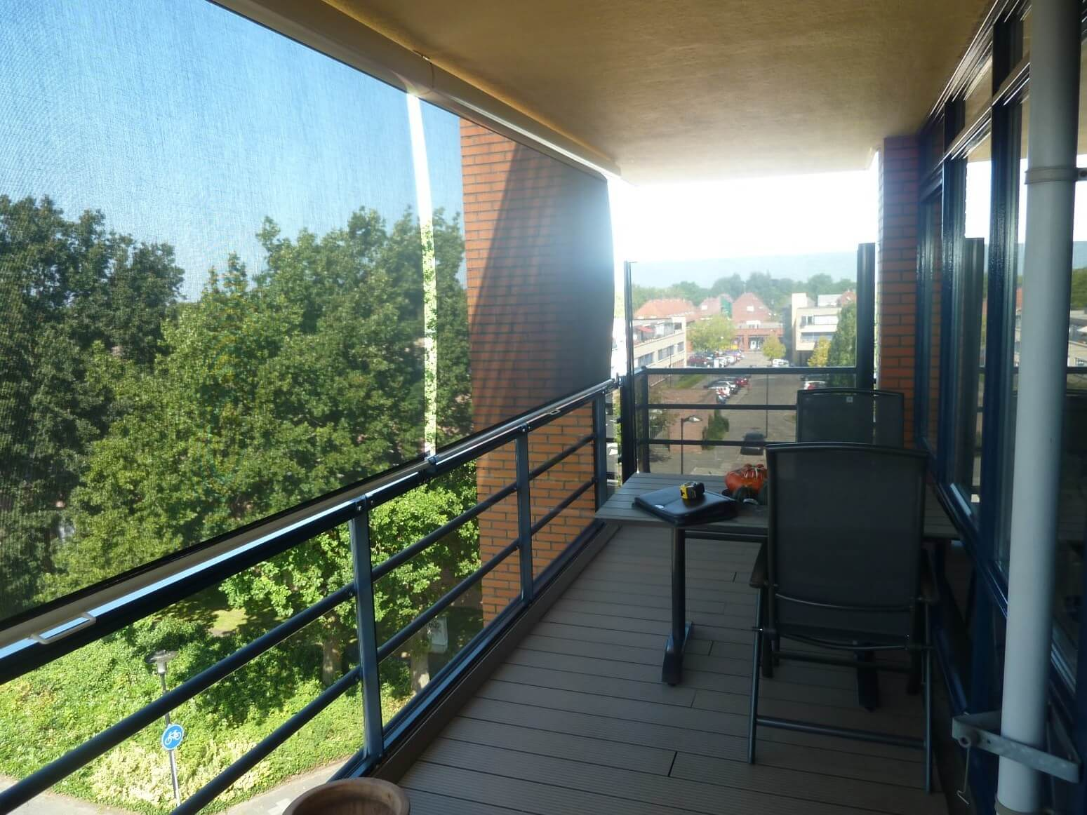 Balkon windscherm, fraaie oplossing.